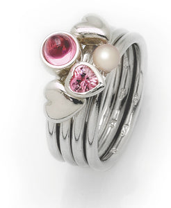 Sterling silver ring with pink heart cubic zirconia and freshwater pearl setting