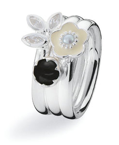 Sterling silver ring combination featuring cubic zirconia, onyx and enamel flower settings