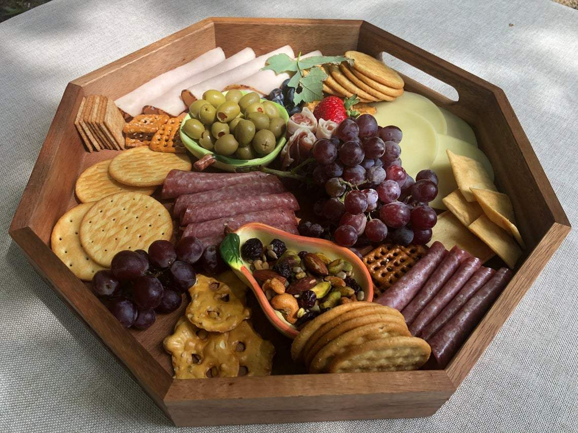 snack food charcuterie in octagon serving tray