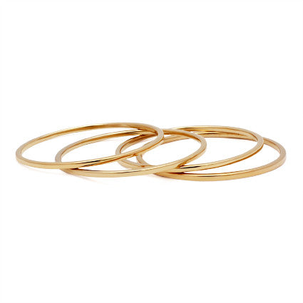set of four thin gold classic bangles