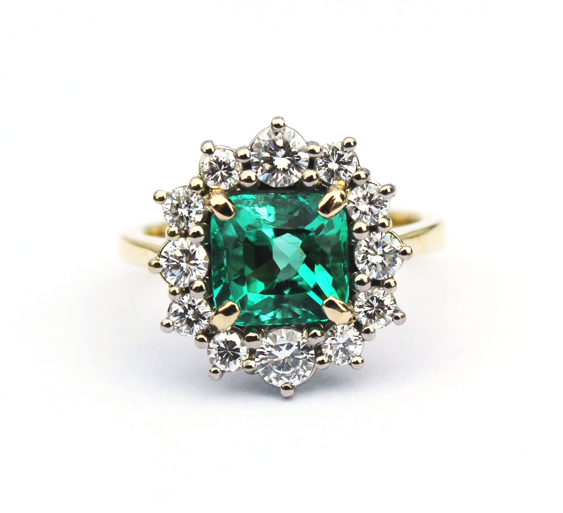 Magnificent Emerald Engagement Ring - Surrounded by round brilliant diamonds.