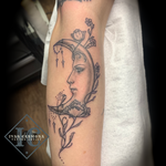 Astronomy Tattoo With A  Bejeweled Moon And Flowers In Black Gray On The Forearm Tatuaje De Astronomía Con Una Luna Adornada, Flores, Y Tinta Negra Y Gris En El Antebrazo<br>
