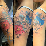 Chilean Bellflower Tattoo On The Shoulder With Many Colors And Blue Accent Splashes
