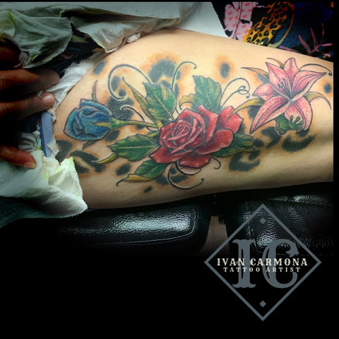 Floral Tattoo With  Colorful Cheetah Print On The Leg Tatuaje Floral Con Estampado De Guepardo Colorido En La Pierna<br>