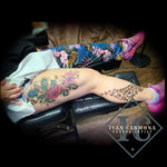 Floral Tattoo With  Colorful Cheetah Print On The Leg