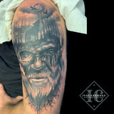 Norse Tattoo On The Arm With A Face Of A Viking, A Moon Sky, And A Wolf In The Trees In Black And  Gray