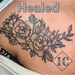 Floral Tattoo On The Clavicle With Black Line Work And Shading