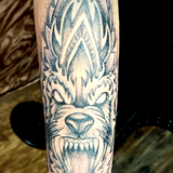 Tribal Wolf Mandala Tattoo In Dot Work Style With Black And Gray Ink On The Hand And Forearm