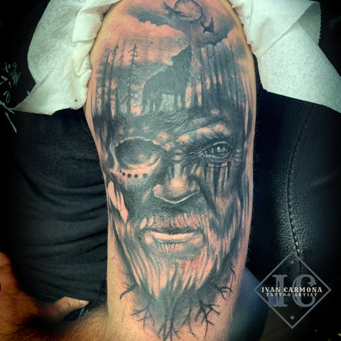 Norse Tattoo On The Arm With A Face Of A Viking, A Moon Sky, And A Wolf In The Trees In Black And  Gray Tatuaje Nórdico En El Brazo Con La Cara De Un Vikingo, Un Cielo Lunar Y Un Lobo En Los Árboles En Negro Y Gris<br>