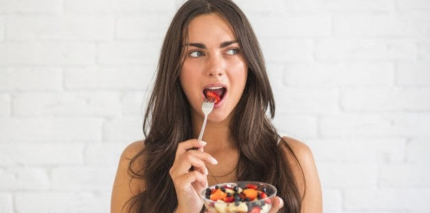 Young woman is eating gluten-free meal