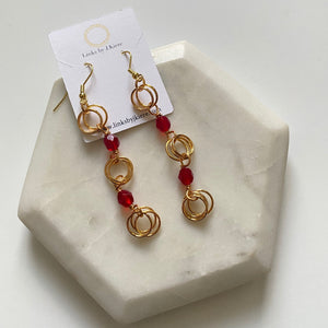 The Kiere Earring in Translucent Ruby Red