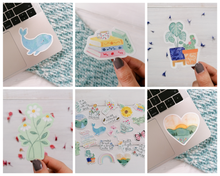 Load image into Gallery viewer, an assortment of cute illustration stickers, from whales to house plants to books to sunsets and daisy stickers