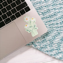 Load image into Gallery viewer, daisy sticker for your laptop, three daisies intertwined on a pale green background