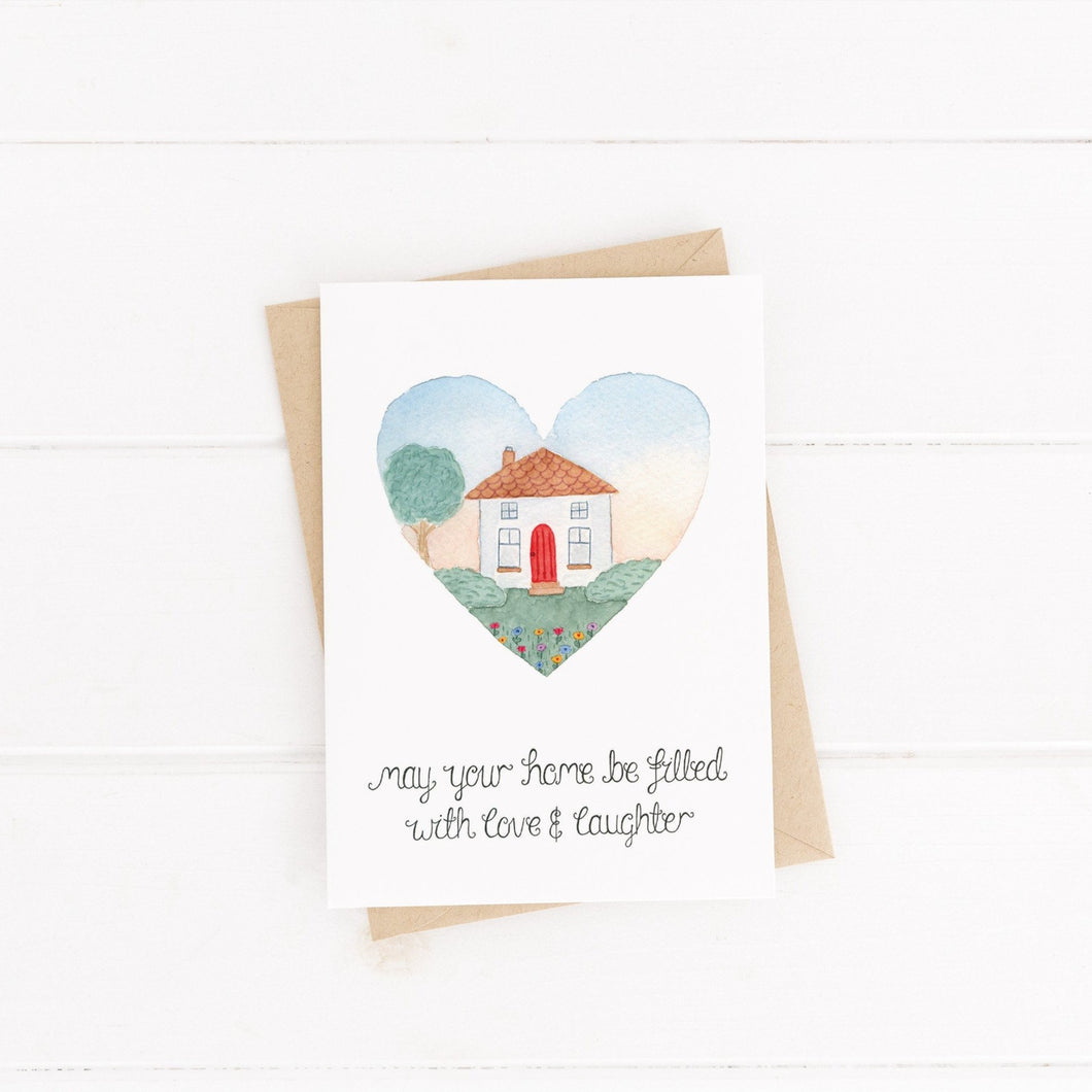 greetings card with the words may your home be filled with love and laughter with an illustration of a house