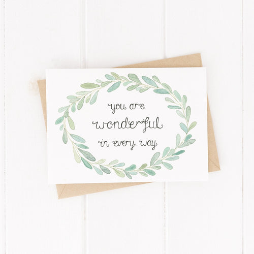 encouraging greetings card with the words you are wonderful in every way at the centre with a hand painted leaf wreath surrounding
