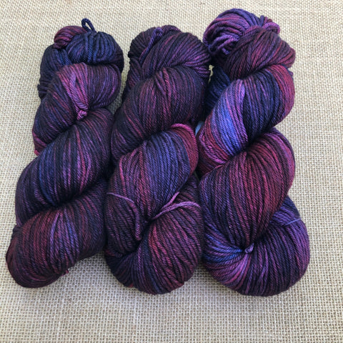Malabrigo Rios Syrah Grapes is variegated shades of purple, blue and red