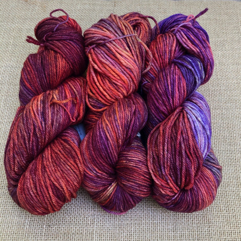 Malabrigo Rios Archangel is variegated shades of red, orange, pin and purple