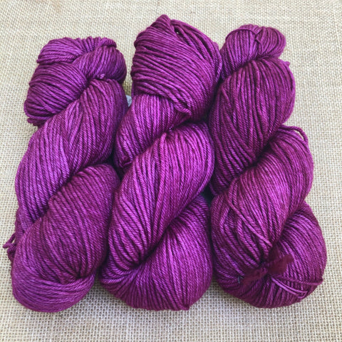 Malabrigo Rios Hollyhock is a bright clear shade of magenta with tonal variations of the same shade