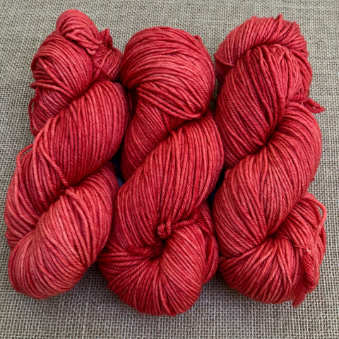 Malabrigo Rios Living Coral is a bright shade of pink-leaning coral