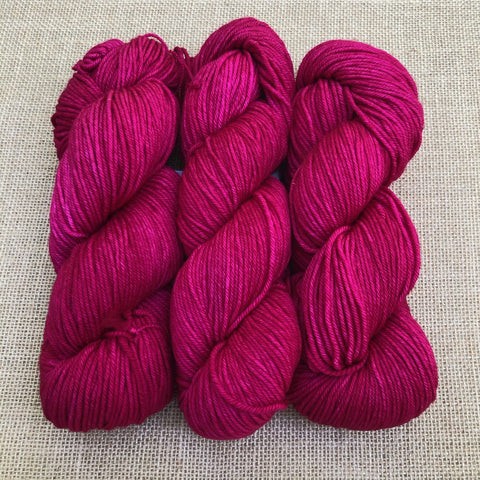 Malabrigo Rios Fucsia is clear hot pink with tonal variations of the same shade