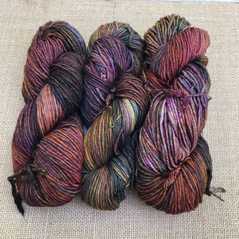 Malabrigo Rios Piedras is heavily variegated with shades of purple, red, brown, orange, gold and green
