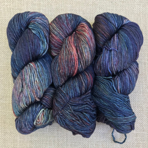 Malabrigo Rios Pocion is heavily variegated with light and dark shades of blue, green, and rust