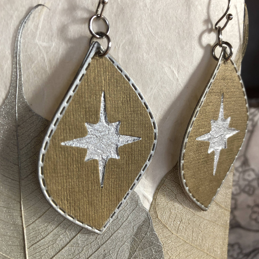 Susan Twining Creations - Silver Northern Stars on Brass Colored Drop Earrings