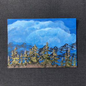 Susan Twining Creations - Greeting Card - Hand Painted Blue Sky, Mountains, and Pine Trees