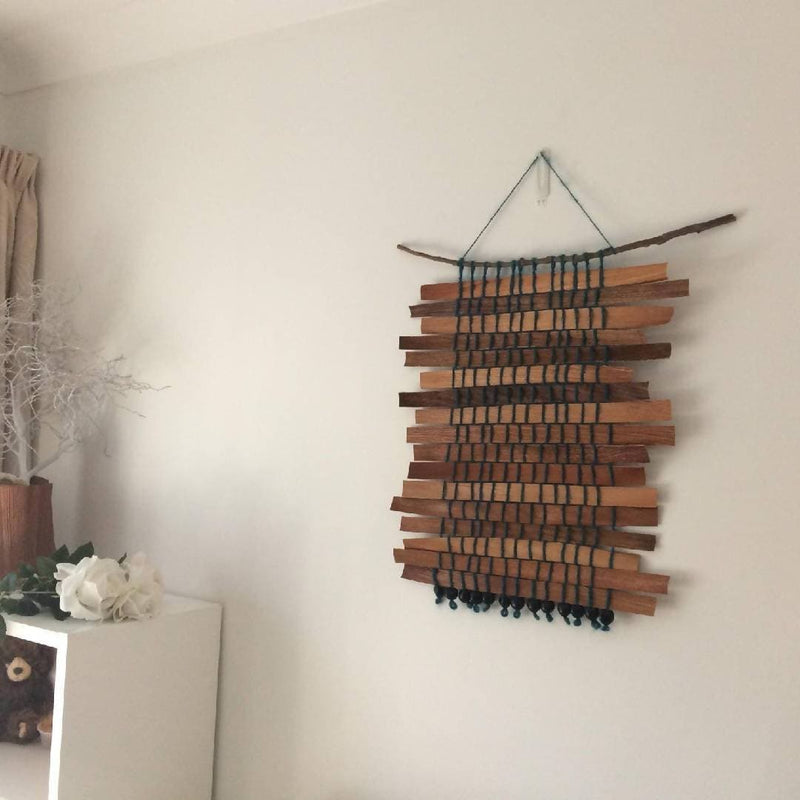 Wall hanging with green wool