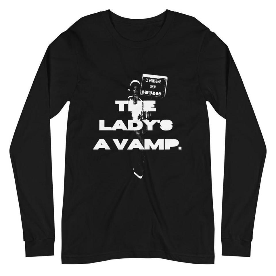 A unisex black long sleeve tee that features a white textured DTG graphic print of a distorted woman holding a sign that says THREE OF SWORDS in a bold gothic font, with bold text that says THE LADY'S A VAMP on top of the image of the woman