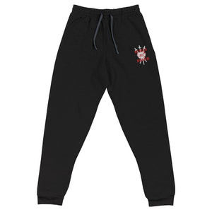 A pair of black embroidered unisex joggers with an embroidered white and red Three of Swords logo, accompanied with text that says VEILED IN FLESH in a goth font, on the upper left thigh.