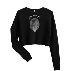"A black cropped sweatshirt with a center graphic that says ""lie with me for eternity"" in a curved font above a black and white photo of a vintage Jewish woman."