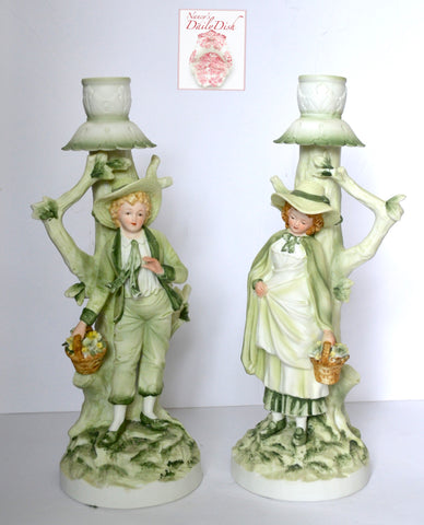 Pair Vintage English / French Country Figural Candlesticks Boy & Girl w/ Baskets of Flowers Green Hand Painted