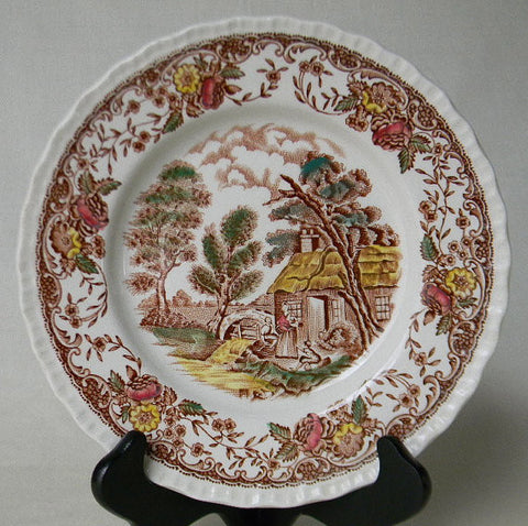 Brown Polychrome Transferware Plate Olde England Mother Holding Infant Children Playing Alongside a Stream