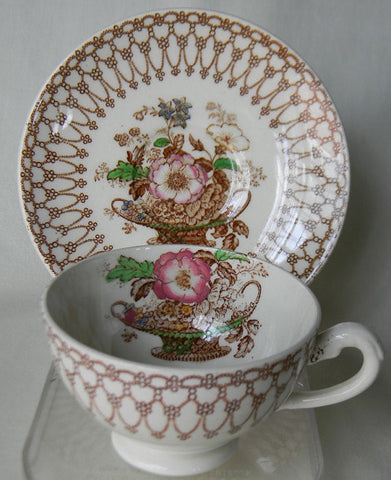 Polychrome Brown Transferware Tea Cup and Saucer Basket of Spring Flowers Vintage and English