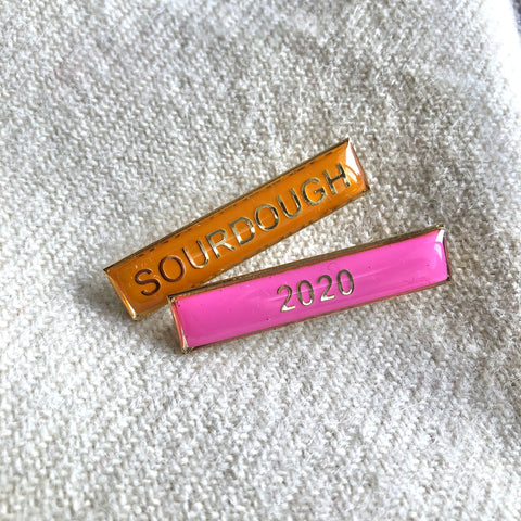"""Cast brass and gold-plated enamel school lapel badges with """"Sourdough"""" and """"2020"""""""