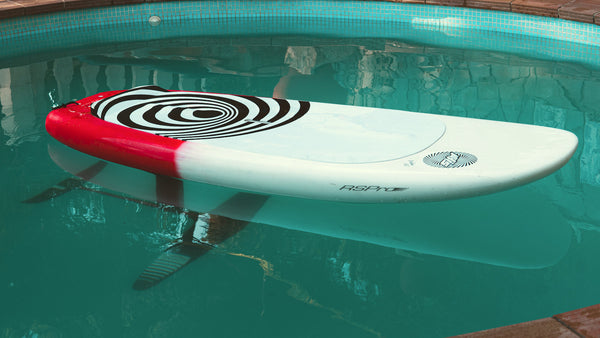 SUP foil board with RSPro clear foil rail saver in the pool