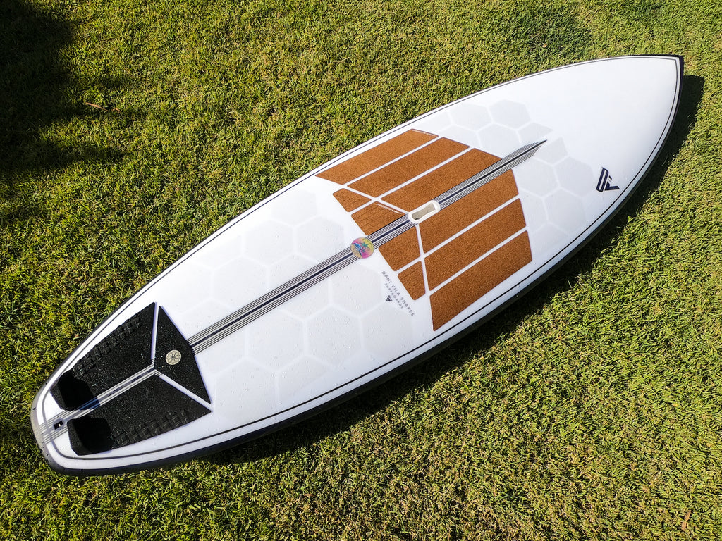 Custom SUP Surf with RSPro HexaTraction and cork Front Deck Grip in the grass