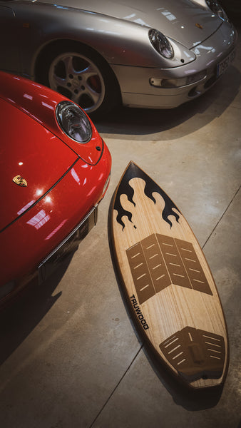 Truwood surfboard with RSPro traction with a couple of Porsche 993