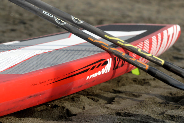 Red Stripes rail saver on a red Fanatic SUP board