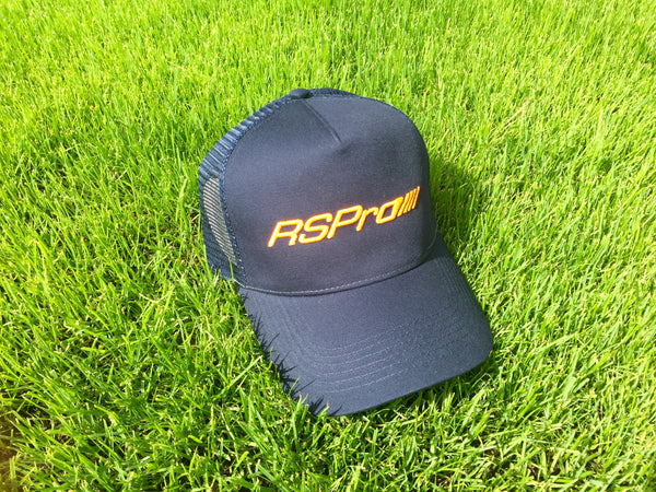 RSPro official cap over the green grass