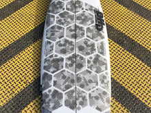 Load image into Gallery viewer, RSPro HexaTraction Camo Edition on a DHD surfboard
