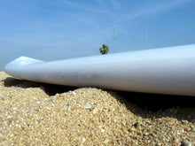 Load image into Gallery viewer, Surfboard laying on beach sand with Surf RSPro rail protection
