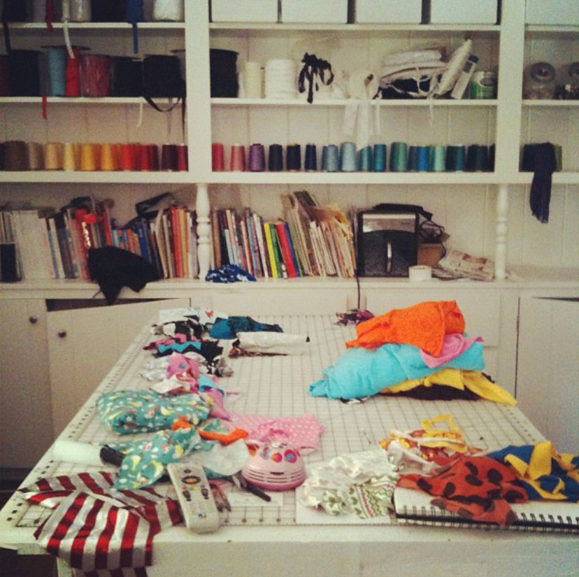 Sewing room work space for designer with coloured threads