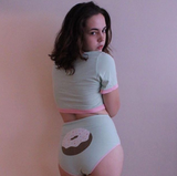 woman wearing donut lingerie set by knickerocker