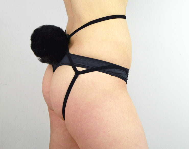 womans bottom bum wearing black fluffy tail strappy harness by knickerocker