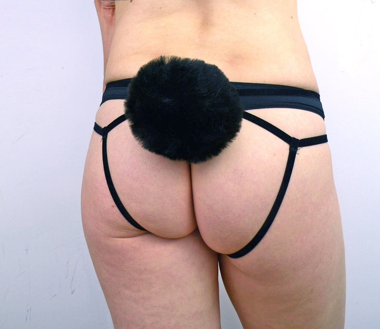 Womans bottom wearing black strappy pantie harness by knickerocker