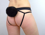 Woman wearing black fluffy tail strappy harness