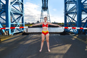 girl in red lingerie set in front of the transporter bridge middlesbrough by knickerocker
