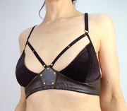 Woman wearing leather and velvet bra lingerie by Knickerocker